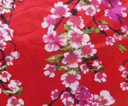 Red fabric with pink cherry blossom