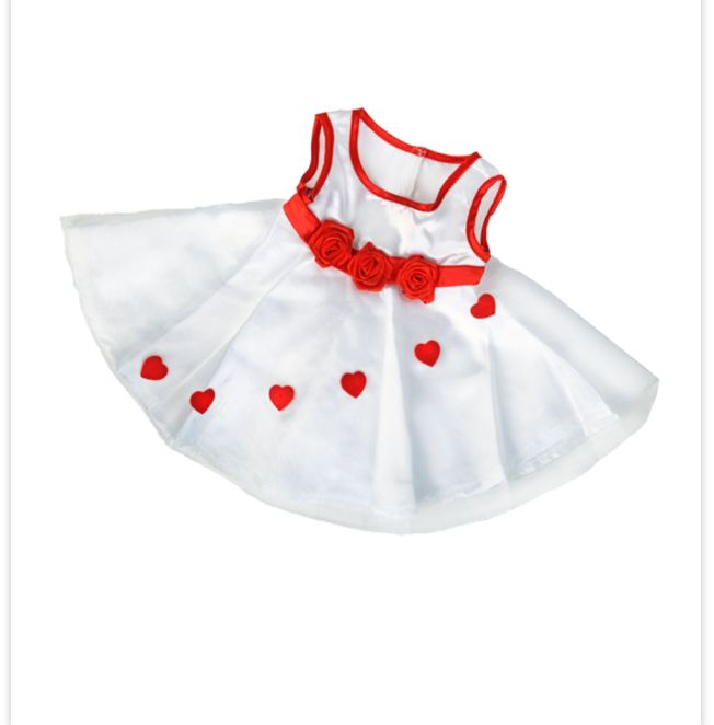 Red hearts on white princess dress.